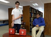 Charleston Catholic Student Donates Automated External Defibrillators To School